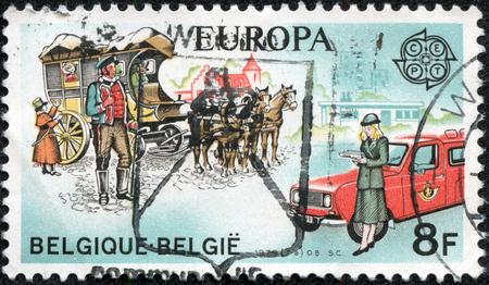 CHONGQING, CHINA - May 11, 2014:A stamp printed by Belgium, shows Mail Coach and Truck, circa 1979