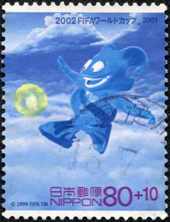 CHONGQING, CHINA - May 11, 2014:A stamp printed in Japan shows mascot for teamwork, series 2002 FIFA World Cup Korea Japan with Contribution, circa 2001.