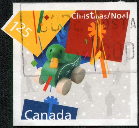 カナダで印刷された 5 月 11 日、中国・重慶 2014:A スタンプ シリーズは、2002 年頃、クリスマスの時おもちゃのアヒルのイメージを示しています。
