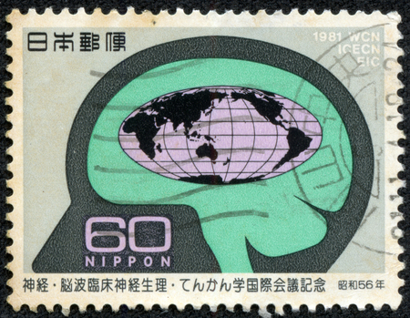 CHONGQING, CHINA - May 22, 2014:A postage stamp printed in Japan shows brain and the world map, series world congress of neurology, circa 1981.