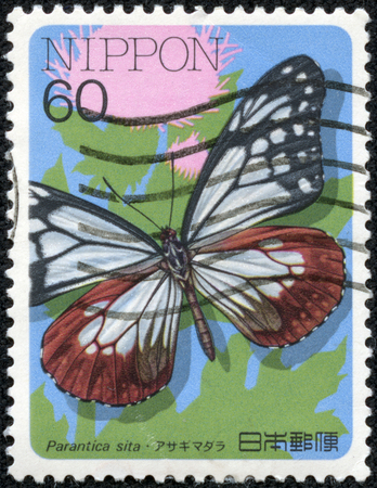 CHONGQING, CHINA - May 11, 2014:A postage stamp printed in Japan shows parantica sita butterfly, series insects, circa 1986.