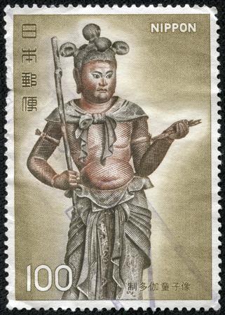 CHONGQING, CHINA - May 22, 2014:A postage stamp printed in Japan shows many Gaya kid statue Buddha figure, series 2nd National treasure, circa 1976.