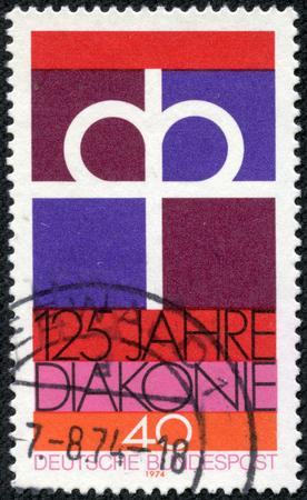 重慶, 中国 - 2014 年 5 月 21 日: 1974 年頃、ドイツのプロテスタント教会の Diaconal 協会の創立 125 周年に捧げドイツで印刷されたスタンプ 報道画像