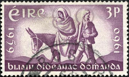 CHONGQING, CHINA - May 11, 2014:A stamp printed in Ireland shows the World Refugee stamp, circa 1960 Editöryel