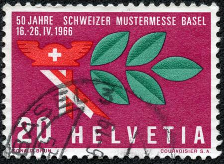 郵便切手がスイス連邦共和国で印刷されたが、スイス サンプル フェア、1966 年頃に専用帽子と月桂樹枝、水銀を示しています重慶、中国 - 2014 年 5