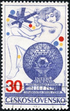 CHONGQING, CHINA - May 11, 2014:A stamp printed in Czechoslovakia, shows Satellite Communication System - Molniya and women. Intersputnik television transmission, circa 1974