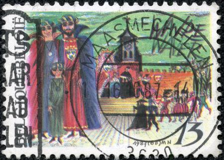 CHONGQING, CHINA - May 11, 2014:stamp printed by Belgium, shows Play of John and Alice, Wavre, circa 1987
