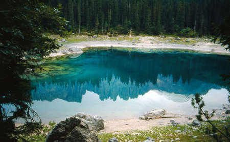 Laternar reflecting in the water of Carezza lake