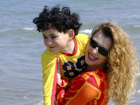 Mother and child playing on the beach