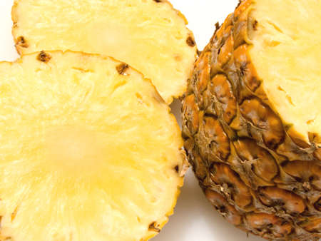 Close-up of half and two slices of pineapple
