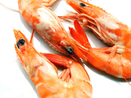 Three shrimps over white background Stock Photo
