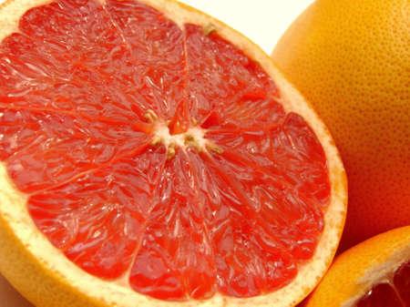 Close-up of a half cut ruby grapefruit