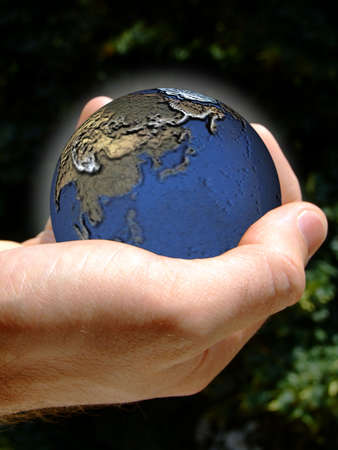 Human hand holding the Earth Stock Photo