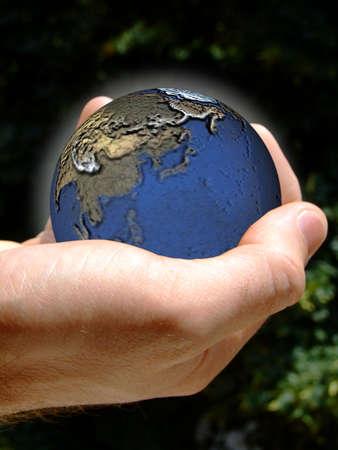 Human hand holding the Earth 版權商用圖片