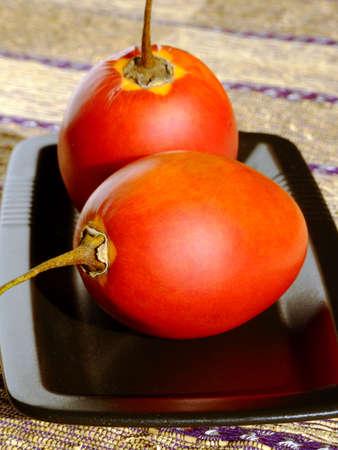 Close-up of two ripe tamarillos