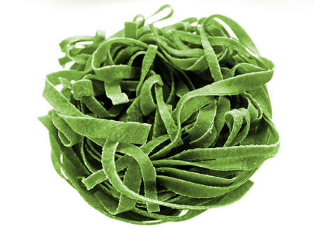 Close-up of raw spinach fettuccine pasta
