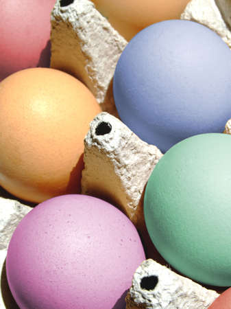 Close-up of some fresh colored eggs photo