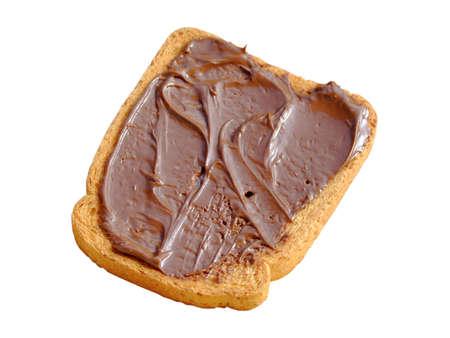 biscotte: Close-up d'un biscuit isol�s avec cr�me au chocolat Banque d'images