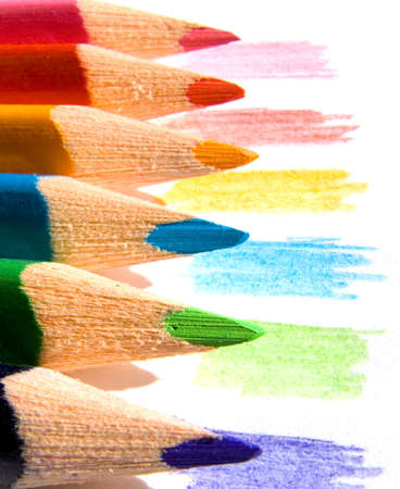 Colored pencils on white paper sheet Stock Photo