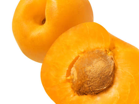 Close-up of fresh ripe apricots over white background