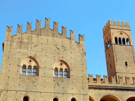 lived here: Bologna, facade and dungeon of the castle located in Piazza Maggiore, called King Enzo palace, because here the king lived in prison until death. Stock Photo