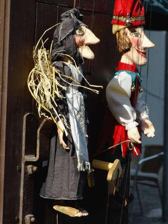 papiermache: Traditional handmade Czech puppets hanging on the door of a little shop