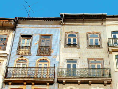 Old houses in historical center, Coimbra with external walls covered by azulejos, typical ceramic tile works