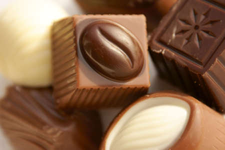 Macro of some mixed filled chocolate candies. Shallow DOF Stock Photo