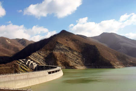 apennines: View of the heart wall of the dam of Ridracoli, the lake and the Apennines on a winter day