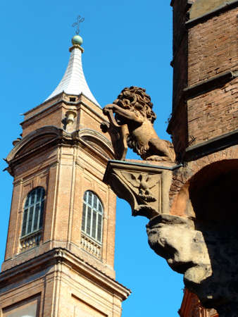 Detail of the lion statue on Asinelli tower and belltower of Saint Bartholomew church in Bologna Stock Photo - 2690096