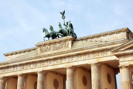 Detail of Brandenburg Gate and the Quadriga bronze statue. In german it is called Brandenburger Tor and its one of the few monuments that survived in the defeated capitol town of Berlin after second world war. King Frederick William II of Prussia commiss