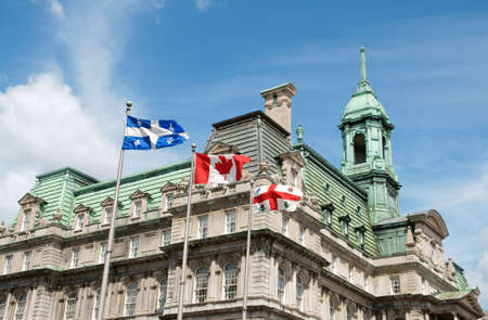 montreal: Old Montreal City Hall and flags of Quebec, Canada and the city