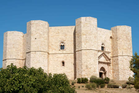 monte: Castel del Monte (Castle of the Mount) is situated on a solitary hill, in the southeast italian region of Apulia, near Andria in the province of Bari. It was built in the 13th century during the reign of the Holy Roman Emperor Frederick II. The castle is  Stock Photo