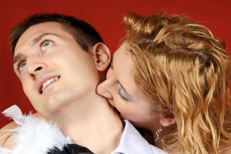 Young female vampire biting her lover's neck Stock Photo - 6265116