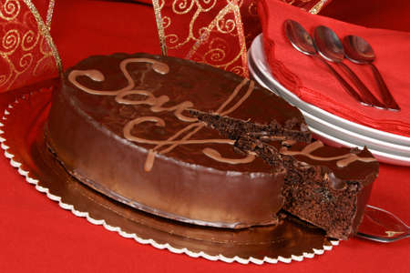 Famous austrian chocolate cake called sacher torte served on a golden plate.