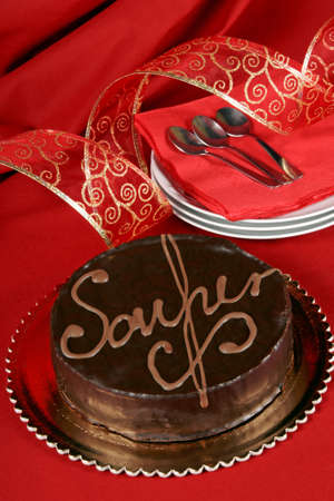 Famous austrian chocolate cake called sacher torte served on a golden plate. Selective focus.