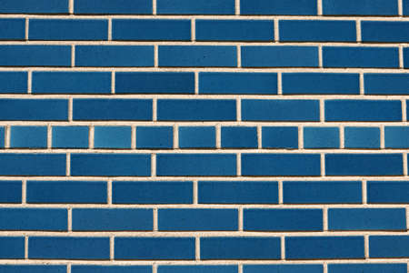 Outdoor wall made of blue ceramic bricks perfect as background or texture