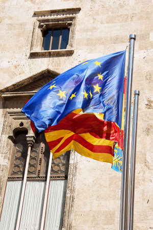 European Union, Spain and Valencia flags in front of Palau de la Generalitat in Valencia, Spain. photo