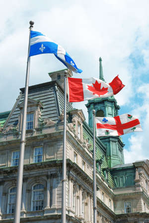 Old Montreal City Hall and Quebec, Canada and city flag