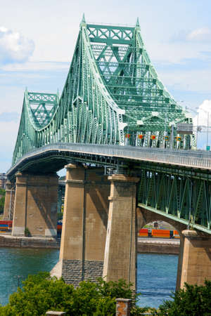 Jacques Cartier bridge crossing Saint Lawrence river in Montreal Stock Photo