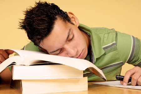 19 years old: Close-up of an hispanic 19 years old student sleeping on books Stock Photo