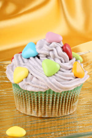 Fancy Valentines Day cupcake decorated with small colorful sugar-coated hearts photo