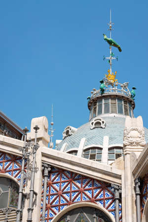 combines: Mercado Central or Central Market of Valencia is one of the oldest in Europe. It combines lots of architectural styles from late gothic to modernism. The building is decorated with tiles and stained-glass windows. Stock Photo