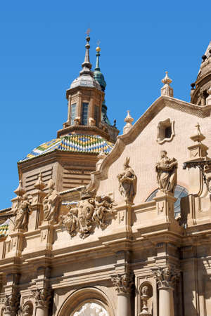 Basilica-Cathedral of Our Lady of the Pillar in Zaragoza is supposed to be the first dedicated to Holy Mary. The first church on this site was Romanesque, the construction of the present one, in Baroque style was begun in 1681 by Charles II, King of Spain photo