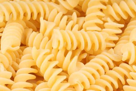 Raw durum wheat fusilli pasta background Stock Photo - 10758486