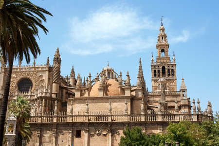 Detail of the gothic and baroque Cathedral of Seville and the famous bell tower called La Giralda