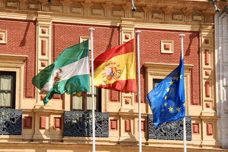 presidency: Flags of Andalusia, Spain and European Community at Palace of San Telmo, the seat of the presidency of the Andalusian Autonomous Government in Seville, Spain.