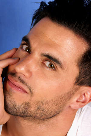 30 years old man: Handsome 30 years old man with black hair and brown eyes portrait over a light blue background