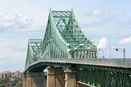Jacques Cartier bridge crossing Saint Lawrence river in Montreal on a cloudy day