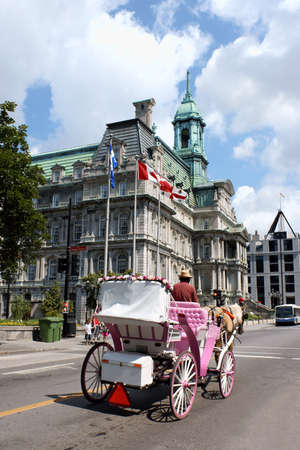 Montreal, Canada - July 26, 2008: Montreal City Hall with its copper roof and flags of Canada, Quebec and Montreal nearby. Built in Second Empire Style between 1872 and 1878 in Old Montreal (Vieux Montreal) the building was seriously damaged by the fire t Stock Photo - 16425451